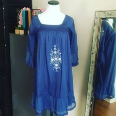 "Blue Bohemian Sundress Hippie Size small fits up to a size medium. Ruffles hem. Floral embroidery. Ocean blue. Same day shipping on all orders. Offers welcome, no trades. 32"" long. Dresses Mini"