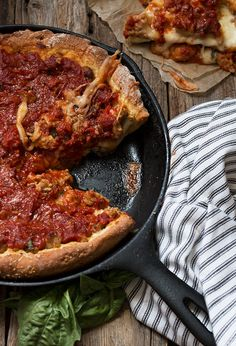 A hearty and delicious cast iron skillet deep dish pizza, with sausage and bacon and a homemade pizza sauce.