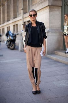 Photo Credit: Diego Zuko..A leather jacket looks utterly current with geometric trousers.