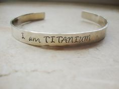 I am Titanium strength silver hammered hand stamped by Lolasjewels, $14.00