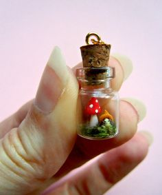 """""""Into this small small small bottle, you will find the tiniest gnome girl. She loves to stand next to a miniature fairy mushroom, and that's enough to keep her fine and safe!"""" Could not have said it better myself.  Made by Silvia Minucelli (MijbilCreatures)."""