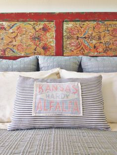 Ticking pillow with grain patch.