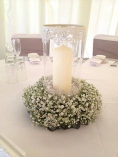 Love these Vintage style hurricane lamp with rings of gypsophila wedding flower centrepieces that we created for one of our brides in April 2014 they looked stunning.