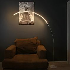 A whimsical floor lamp that looks like an arched lightsaber. | 33 Products That Will Turn Your House Into A Minimalist Dream