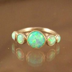 gold and opal! pretty - would have to be a gift thought, opal is bad luck unless it's a gift (says my mom)