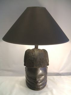 Stunning antique African Mende wood headdress as lamp......go to dustysimi.com