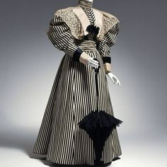 1895-96 dress by A. Sills, New York. Silk satin, silk velvet, silk faille, machine-made lace.