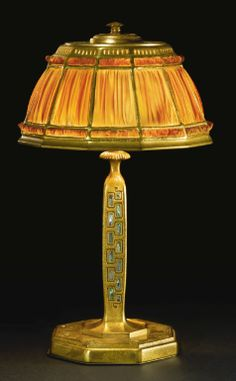 """Tiffany Studios """"FAVRILE FABRIQUE"""" DESK LAMP Estimate: 10,000 - 15,000 USD in the """"Abalone"""" pattern  shade impressed TIFFANY STUDIOS/NEW YORK/1928 base impressed TIFFANY STUDIOS/NEW YORK/604 favrile glass, gilt bronze and abalone shell - At Auction Southeby's New York Dec. 15, 2012"""
