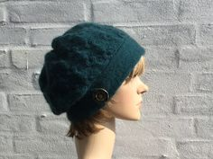 Hand knitted cloche style hat knitted with pure 2-ply QIVIUT by Made4Umnn on Etsy