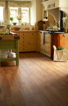 Camaro Vintage Timber luxury vinyl tile flooring with Brown feature strip to create ships decking look in rustic kitchen