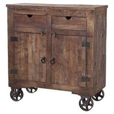 Two-door wood cabinet with a hand-painted finish and caster feet.  Product: CabinetConstruction Material: Solid hardwood and metalColor: Spice roadFeatures:  Interior storageTwo doorsHand-painted finish Dimensions: 40'' H x 40'' W x 14'' D