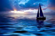 Sunset sailing in the middle of a calm Pacific Ocean