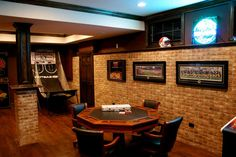Wonderful-Basement-Video-Game-Room-Ideas-With-Poker-Table-And-Chairs-On-Wood-Floors-Also-Brick-Wall-Pattern-As-Well-As-Ceiling-Lights-Installation-Ideas