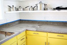 Smart.   The Formica counter tops were used as the base for covering with concrete. Much more thrifty than molded concrete counter tops.