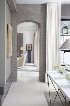 Great assorted textures - painted brick, flowing curtain and herringbone floor.