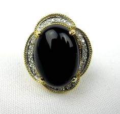 Women's 14K Yellow Gold Onyx Diamond Ring, Vintage Ladies Cocktail Ring Size 7, 1980s by SobellsBoutique on Etsy https://www.etsy.com/listing/532225072/womens-14k-yellow-gold-onyx-diamond-ring