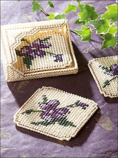 "The radiant blooms of these glorious coasters make any coffee break a gracious affair. Size: Coasters: 3 7/8"" square. Holder: 4 1/4"" x 4 1/4"" x 1 1/8"". Skill Level: Beginner"
