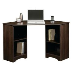 Sauder Beginnings Corner Desk - Cinnamon Cherry by Sauder. $75.44. Dimensions: 23.5L x 53.13W x 28.75H inches. Desktop features 2 grommet holes for cord management. 2 adjustable shelves. Cinnamon cherry finish. Constructed of environmentally friendly engineered wood. 413073 Color: Cinnamon Cherry Features: -Desk top has two grommet holes for cord management. Collection: -Beginnings collection.