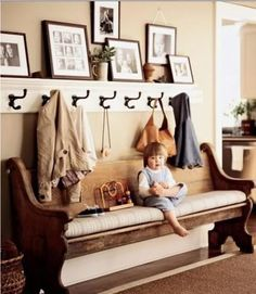 Re-purposed church pew. An awesome idea for M & R's entryway. Can even put some lined wicker baskets underneath the pew for shoes or whatever. R could always make the shelf/coatrack :)
