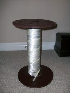 found a wire holder thing from a construction site, spray painted and added ribbon to make it a giant spool sidetable for my room:)
