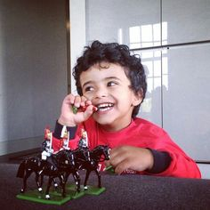 Young Mo with toys