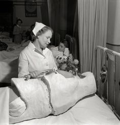 """Nurse and patient in """"corrective cast"""" at Babies' Hospital, New York, 1942. http://www.shorpy.com/node/21052 Fritz Henle"""