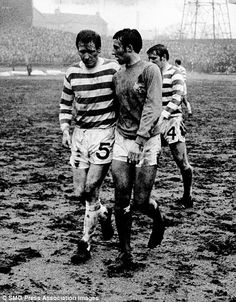 Celtic's Billy McNeill and Rangers' Ron McKinnon walk off together at the end of the 1970 Scottish Cup quarter-final