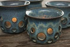 Perfect for any time of the year!  Light up any room with one or several of these handmade stoneware tealight luminaries! With a variety of colors to choose from, each luminary comes with a clear glass tealight holder, ready for you to add a tealight.Hand Thrown Ceramic Luminaries  Small In Three by BackPorchStudio, $14.00