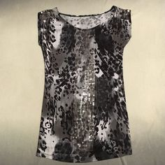 Black & Gray Cheetah Print Dress w/ Clear Sequins a.n.a Brand short sleeve dress/tunic that is a light gray/white, dark gray, and black cheetah print. It has clear sequins in a thick line down the middle of the dress on the front and on the tops of the sleeves. In great condition! The few times I wore this dress I wore it with a black pair of leggings and black boots! a.n.a Dresses
