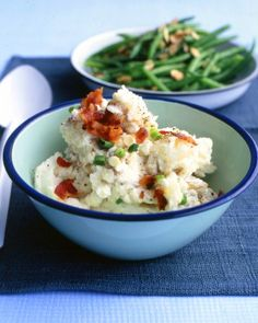 Potato Salad with Sour Cream and Scallions - Reduced-fat sour cream, scallions, and crumbled bacon give this potato salad the flavor sensations of a loaded steakhouse baked potato. This salad can be made up to a day in advance.