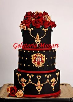 Black wedding cake with red roses, in baroque style  Cake by gelateriamozart
