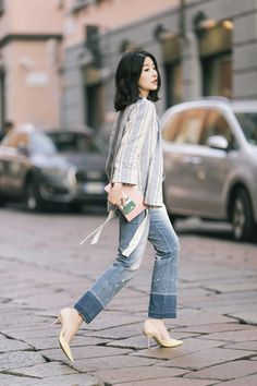 MAX&Co. Xin Xin Zhang crosses the street in style in our striped linen blazer