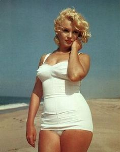 Beach Blonde Marilyn. Look at that body!  In 2012 she would be considered fat.....time doesn't make all things better.  Girls should look up to her for their body image...not Kate Moss.
