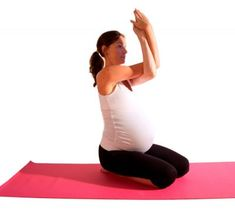 Stiff upper back? Try this pregnancy yoga eagle pose to help ease the pain! Click for more poses and ways to use #yoga to help your #pregnancy