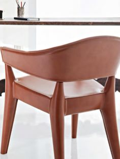 JO CUOIETTO incorporates the soft shapes of the seats Jo, entirely covered with a refined and elegant hard leather in various colors of your choice. The finishes of this chair are admirable hallmark of fine craftsmanship of Alma. #almadesign #italy #design #miami #showroom #wynwood #indoor #furniture #color