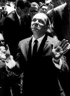 Frank Sinatra with his hands covered in cement, after making an inprint at Grauman's Chinese Theater in Hollywood