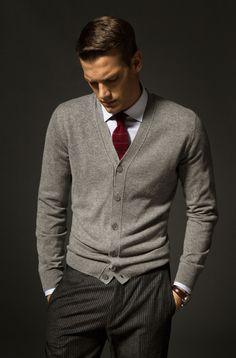 Gray wool cardigan, wool pinstripe trousers, white shirt, burgundy silk necktie.