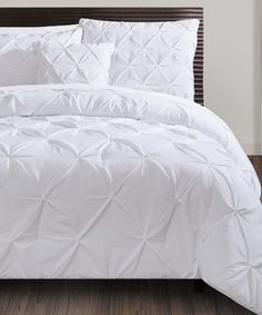 Take a look at this White Carmen Four-Piece Comforter Set today!