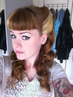 victory rolls with bangs...  how I would wear my hair if I had the time and energy.