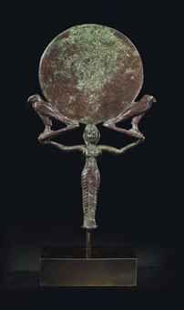 AN EGYPTIAN BRONZE MIRROR MIDDLE KINGDOM, CIRCA 2040-1750 B.C.