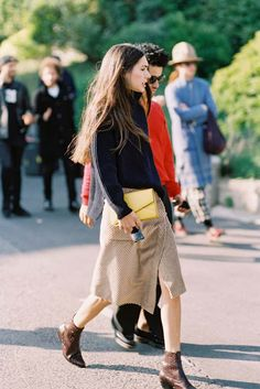 After Kenzo, Paris, October 2015. Love this lovely look: a cosy turtleneck sweater and neutral wrap skirt with a little zip of buttercup yellow! Recreate her lo