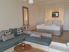 Naxos Hotel Apartments, Villas and Suites at Kavos boutique hotel, superior accommodation in Naxos with great sea views above the spectacular sandy beach of Agios Prokopios Honeymoon Suite, Top Restaurants, A Boutique, Swimming Pools, Greek, Villa, Studio, Bed, Furniture