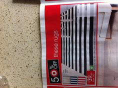 Striped dhurrie rug from Target (Australia) in black, beige, navy or red with white. 160cm x 230cm. $79 when not on sale
