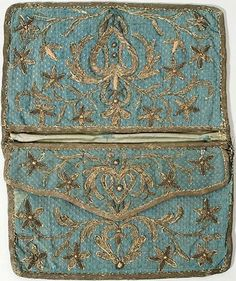 Metallic embroidered silk pocketbook  mid 18th century  Fine hand embroidery was both an art form and a status symbol  in the 18th century. Embroidered designs of gold and/or silver required great skill to execute and were generally done by a professional embroiderer for an aristocratic customer.