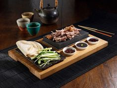 SteakStones - the Home of Hot Stone Cooking. Buy the original and best hot stones for cooking. More designs than Black Rock Grill, Stone Grill, Hot Rocks and Lava Rock Cooking put together and always the very best quality. Duck Pancakes, Pancake Roll, Cooking Stone, Good Food, Yummy Food, Fun Food, Cooking Beets, Teppanyaki, Duck Recipes