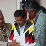 Secretary of Veterans Affairs Eric Shinseki receives a star quilt from Charles Murphy, Standing Rock Sioux Tribe Tribal Chairman, and Chairman Tex G. Hall, Mandan, Hidatsa, and Arikara Nation, at the United Tribes Technical College (UTTC) in Bismarck, N.D., July 5, 2011.   Veterans News Now