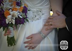 Great close up of the wedding rings, bouquet and the details of the wedding dress.