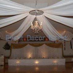 Wedding Ceiling Decor - perhaps a hula hoop around the chandelier.  Lots of tulle and led lights.  Dick can do this. Ha!