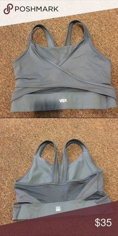 Victoria secret sport grey sports bra size medium Worn once grey sports bra. Beautiful mesh design. Size medium. Victoria's Secret Tops