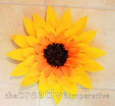 DIY felt sunflower door decoration (or anywhere).  Gotta make it for a new summer decoration.